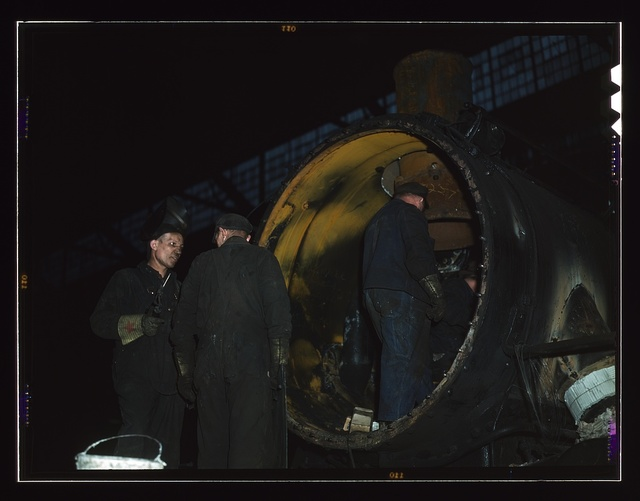 Working on the boiler of a locomotive at the 40th Street shops of the C & NW RR, Chicago, Ill.