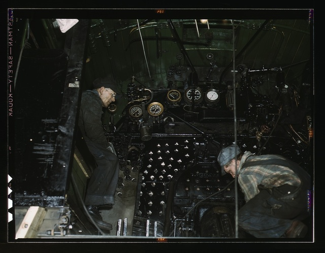 Working on the cab of a locomotive brought in for repair at the C & NW RR 40th Street shops, Chicago, Ill.