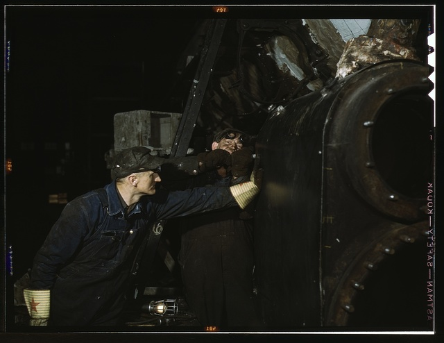 Working on the cylinder of a locomotive at the C & NW RR 40th Street shops, Chicago, Ill.