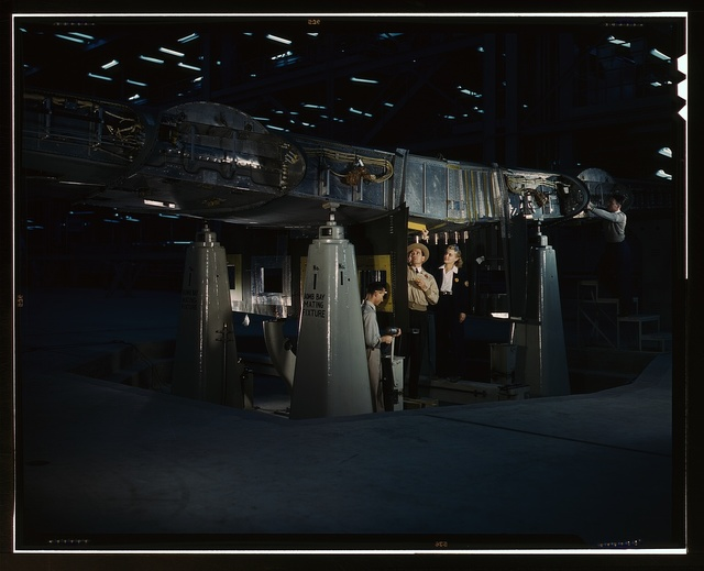Working on the wing center section at the Consolidated Aircraft Corporation plant, Fort Worth, Texas