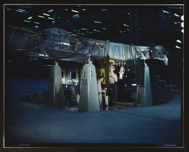 Working on wing of Consolidated Liberator Bomber, Consolidated Aircraft Corp. plant, Fort Worth, Texas