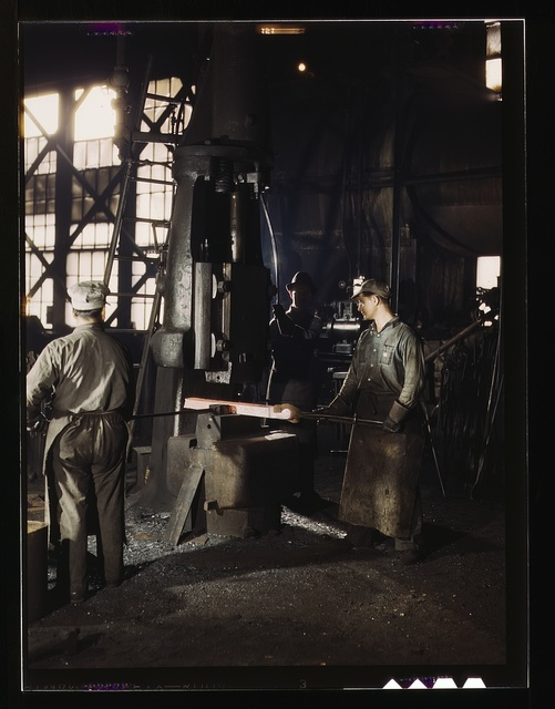 Working with a small steam drop hammer at the blacksmith shop in the Santa Fe R.R. shops, Topeka, Kansas