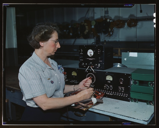 Working with the electric wiring at Douglas Aircraft Company, Long Beach, Calif.