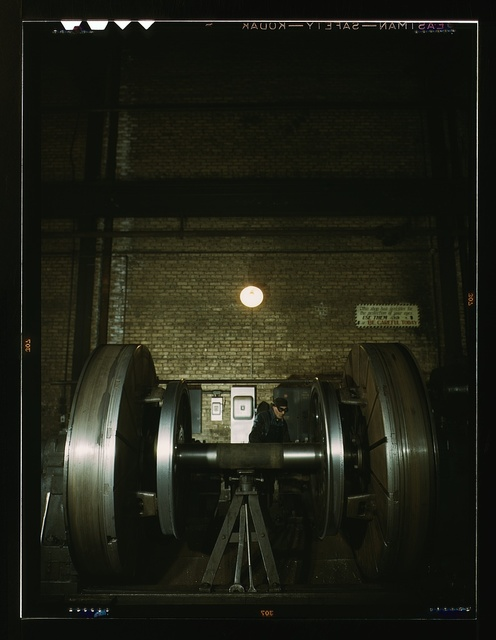 Worn tires on locomotive wheels are refaced on this machine in the wheel shop of the Chicago and Northwestern Railroad, Chicago, Ill.