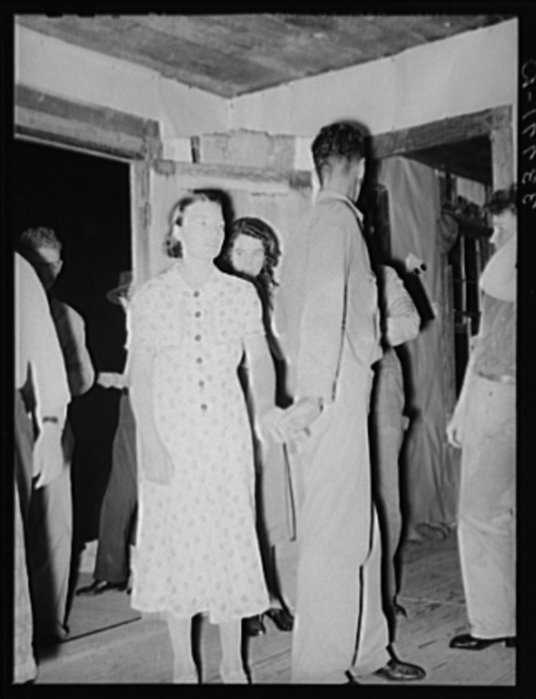 Young couple at square dance in rural section of hills near McAlester, Pittsburg County, Oklahoma. Sharecropper's home