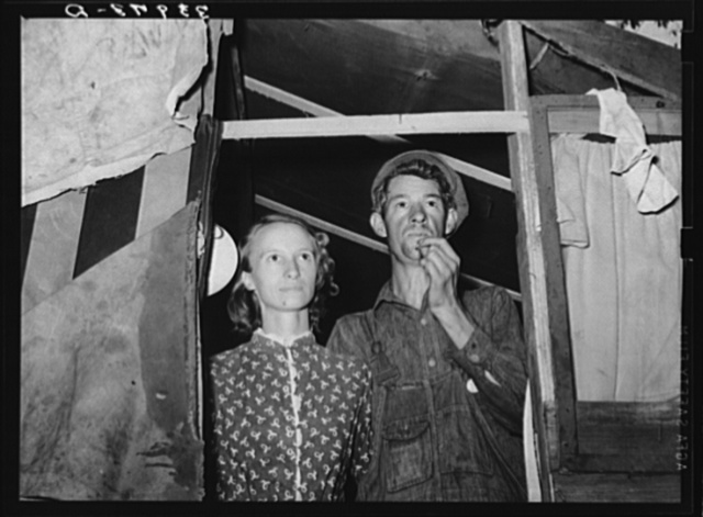 Young couple in doorway of their tent home. Community camp, Oklahoma City, Oklahoma. See general caption 21