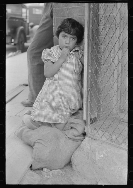 Young Mexican girl who was playing around relief line in San Antonio, Texas
