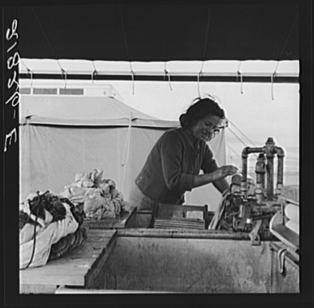 Young migrant girl makes use of facilities provided for cleanliness. Merrill FSA (Farm Security Administration) camp, Klamath County, Oregon. See general caption 62