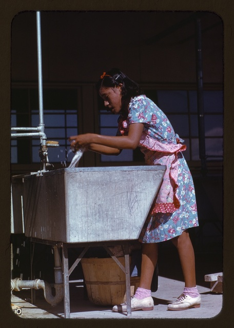 Young woman at the community laundry on Saturday afternoon, FSA ... camp, Robstown, Tex.
