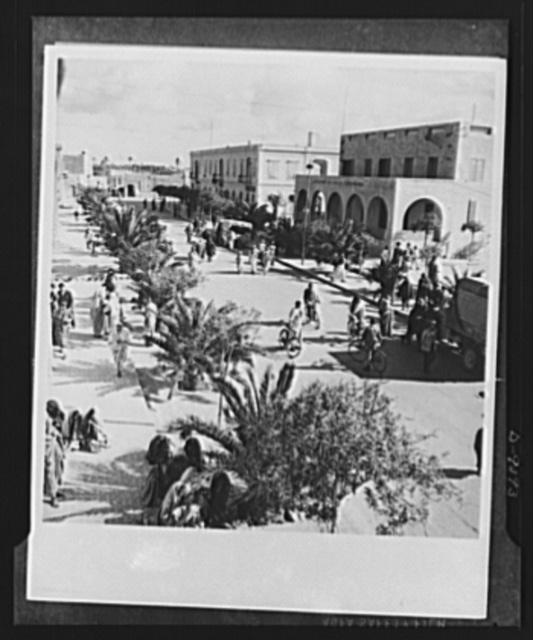 8th Army in Tripoli. Misurata in North Africa, shown from the balcony of its city hall, the morning after the entrance of the British 8th Army. The friendly citizenry go about their daily tasks. Curious men investigate an army truck to the right