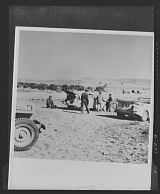 8th Army in Tripoli. Time out on the road to Tripoli for a veteran tank crew of the British 8th Army. Officers use the rest period to consult their maps and routes