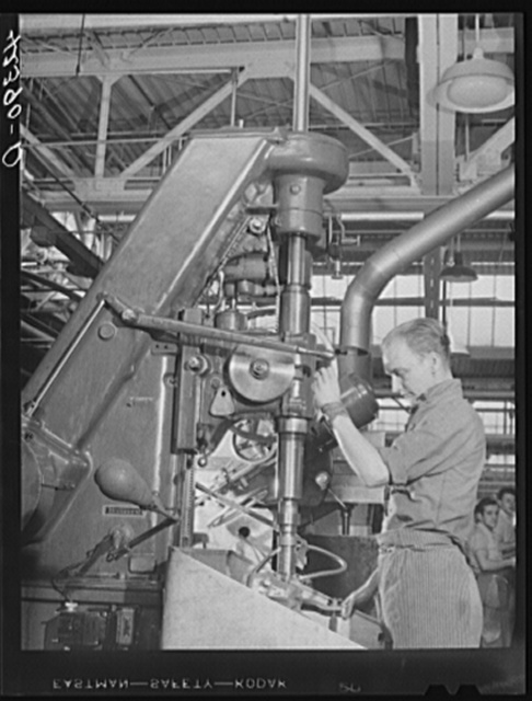 A drill press in operation at the Pratt and Whitney Aircraft Corporation. East Hartford, Connecticut