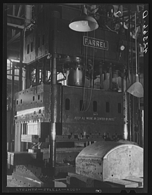 A giant press used to stamp out parts for airplane bodies at the Vought-Sikorsky Aircraft Corporation. Stratford, Connecticut