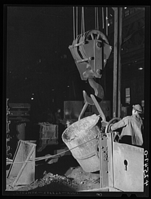 A ladle full of molten steel being moved into position for emptying in the foundry of the Farrell-Birmingham Corporation. Ansonia, Connecticut