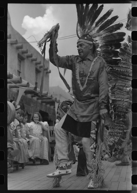 A member of the Forest Service who is participating in Indian dances at the fiesta, Taos, New Mexico