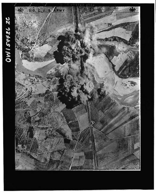 A Nazi bridge is put out of commission. Black smoke engulfs a railway bridge on the line from Florence to Rome after it was straddled by bombs. For two months Allied bombers pounded German railroad installations forcing the enemy to depend increasingly upon cargo vessels and motor vehicles for transportation