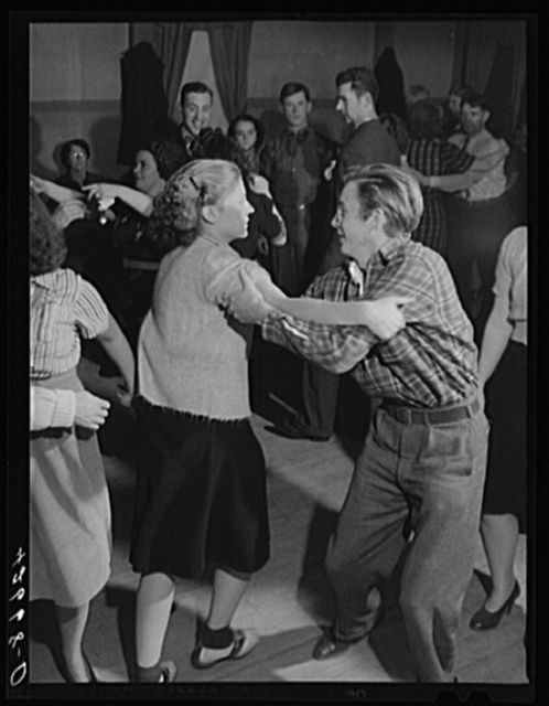 A Saturday night square dance run by Mr. and Mrs. Tucker in Clayville, Rhode Island. Mr. Tucker is the town police force