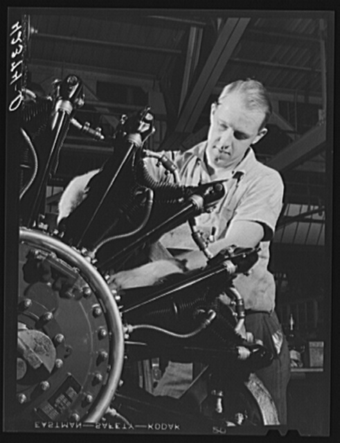 "A workman on the final assembly of a Pratt and Whitney ""WASP"" engine. East Hartford, Connecticut"