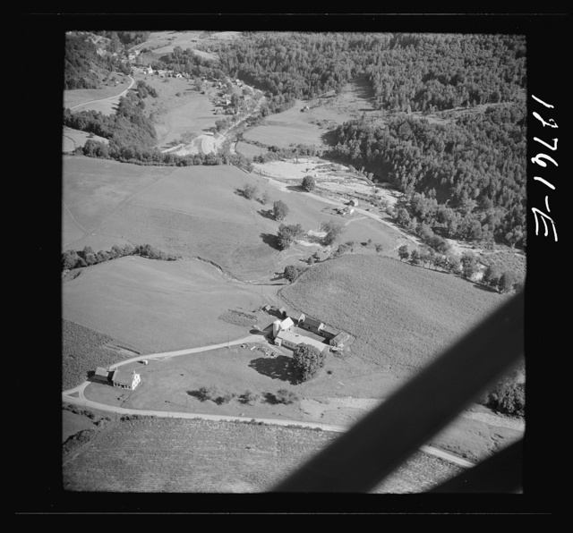 Air view. Farm with town of Lincoln in distance. Lincoln, Vermont