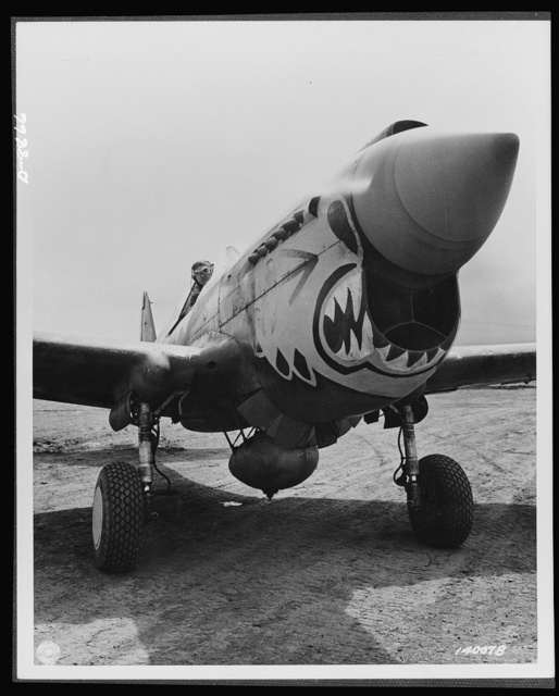 """Aircraft. Army. One of the redoubled """"Flying Tigers"""" ready to take off from an Alaskan point in a Curtis P-40 """"Warhawk"""" fighter plane. The group to which he belongs is commanded by Major John Chennault, son of the famous general. Planes of the series to which this belongs have seen action in almost every known theatre in England and"""