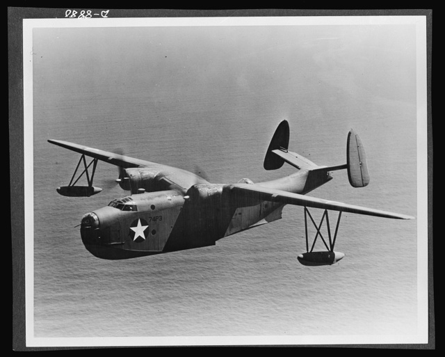 "Aircraft. Naval. The Consolidated ""Mariner"" (PBM-3) serves the Navy as a patrol bomber or transport. It is an all-metal flying boat with high gull wings. It has a speed of over 200 miles per hour, a range of over 3,000 miles, a ceiling of over 15,000 feet and a load capacity of 20,000 pounds. The crew of nine men is armed with 50-caliber machine guns and bombs"