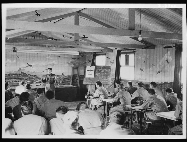 """Aircraft recognition training for United States of American personnel in Northern Ireland. At an aircraft recognition school in Northern Ireland U.S.A personnel are receiving training from British instructors. The instructors are drawn from a light A.A. training regiment of the Royal Artillery. War correspondents from the """"Belfast Telegraph"""" and Belfast Newsletter visited this training school recently"""
