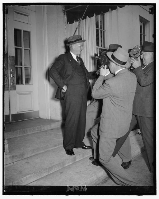 Alf Landon, Repub. nominee for presidency in 1936, facing a battery of cameras when he arrived at White House for luncheon conference with Pres. Roosevelt