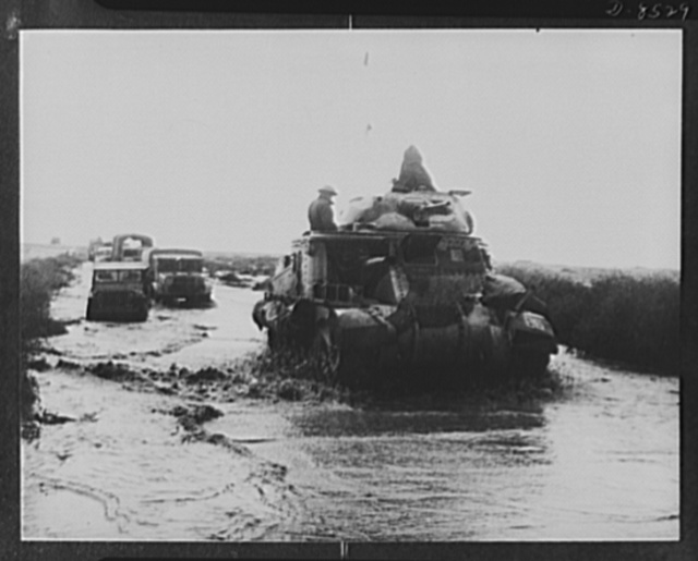 Allies advance in Libya. At the height of the Allied pursuit of the Axis forces heavy rain fell in the Western Desert turning the sand and dust into mud and flooding low-lying parts. It made things difficult for the Axis, but even more so for the British troops, like these General Grant tanks ploughing through a wet and muddy stretch of road