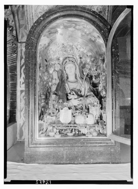 Altar. Bedecked statue of the Virgin above the altar of 13th station [of the Cross] on Calvary