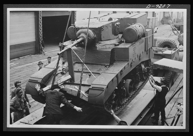 American lend-lease equipment is playing a vital part in the development of United Nations mechanized forces. Here, an American light tank, to be used for training Australia's armored crews, is unloaded at an Australian port