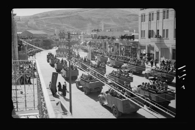 Amman. 24th anniversary of Arab revolt under King Hussein & Lawrence, celebration Sept. 11, 1940. The parade in municipality square