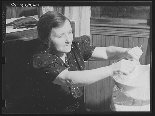 An Italian farm woman near Providence, Rhode Island preparing spaghetti