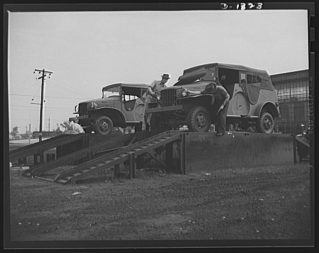 Army truck manufacture (Dodge). Before Dodge Army trucks are shipped or driven to the various army posts throughout the country where they will be put service, U.S. government inspectors, as shown above, check each unit thoroughly before it goes into the yard