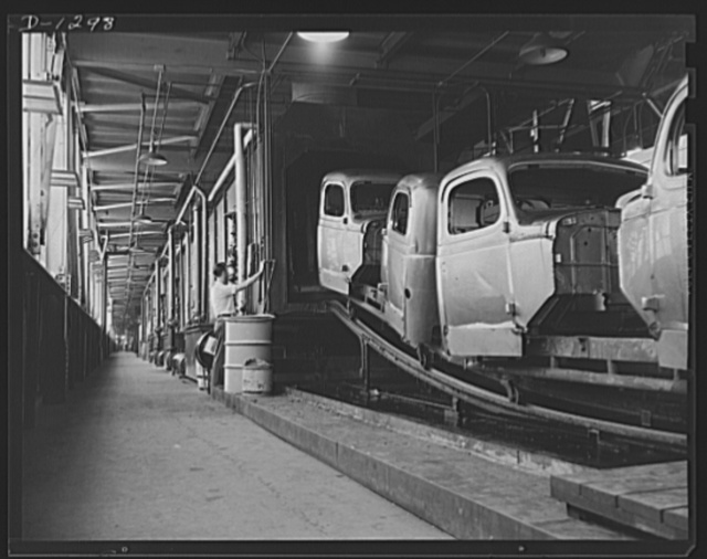 Army truck manufacture (Dodge). Cab assemblies entering huge rust-proofing ovens. In this process the raw sheet metal of the cabs is treated with various chemicals before any finishing coats are applied. This rust-proofing insures against the spread of rust in cases of accidents which damage the finish of the metal after the trunk has been put into service