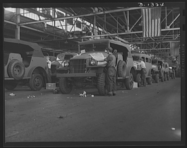 Army truck manufacture (Dodge). Each Dodge truck that goes into the service of the U.S. Army bears the government serial number stenciled on the hood. In the above picture, men working on the two production lines are putting the stencils in place