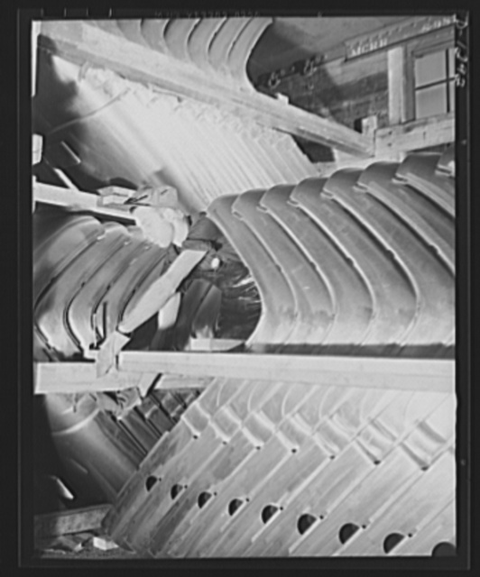 Army truck manufacture (Dodge). Lines of sheet metal formed into top and back panels for the cabs of Army trucks arrive at the truck plant daily in huge shipments loaded compactly into railroad freight cars. Four carloads are required for an average day's production