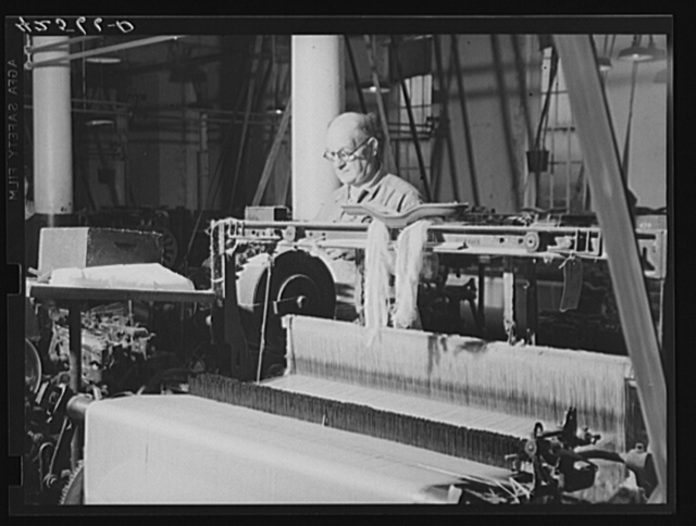 At a loom in the Denomah Mills, Taftville, Connecticut. Makers of rayon and cotton cloths