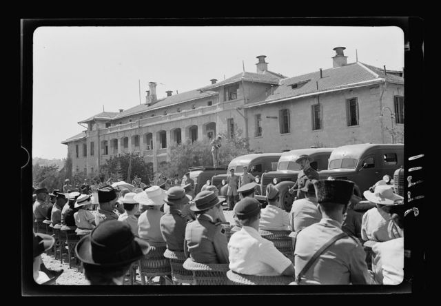 Australian gift to British Red Cross of 9 Red Cross ambulances. Col. The Hon. Harold Colieu, overseas commissioner to Aus. Red Cross Soc. [i.e., Australian Red Cross Society], taken behind the audience
