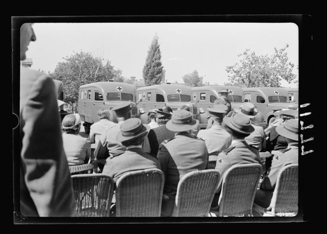 Australian gift to British Red Cross of 9 Red Cross ambulances. Col. The Hon. Harold Colieu, overseas commissioner to Aus. Red Cross Soc. [i.e., Australian Red Cross Society], taken from behind the audience, closer up