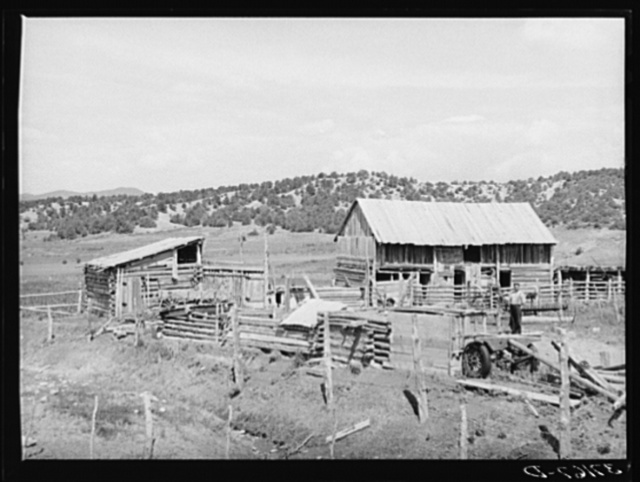 Barns and outbuildings of Spanish-American farmer. Chamisal, New Mexico