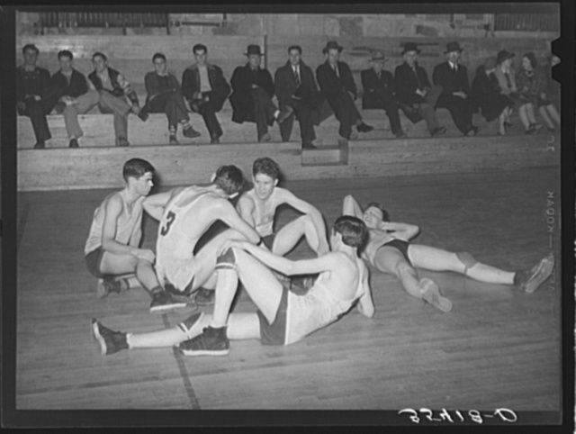 Basketball players resting between periods. Eufaula, Oklahoma
