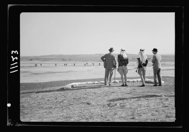 Beersheba, inspection of Camel Corps by H.E. (i.e., His Excellency) Sir Harold McMichael. H.E. (i.e., His Excellency) & party watching exercise of sham battle