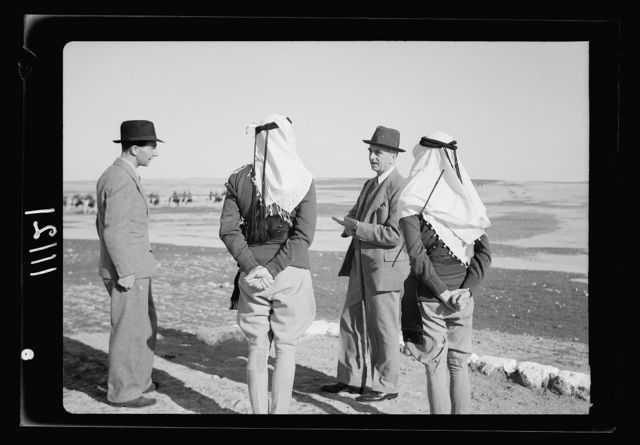 Beersheba, inspection of Camel Corps by H.E. (i.e., His Excellency) Sir Harold McMichael. H.E. (i.e., His Excellency) talking with Mr. Bell (Acting District Commissioner) & Br. [i.e., British] Officer Command Camel Corps