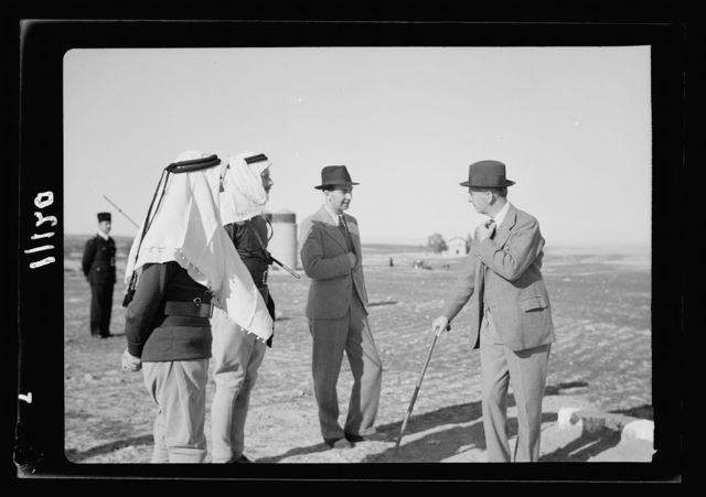 Beersheba, inspection of Camel Corps by H.E. (i.e., His Excellency) Sir Harold McMichael. H.E. (i.e., His Excellency) arriving on dais for review