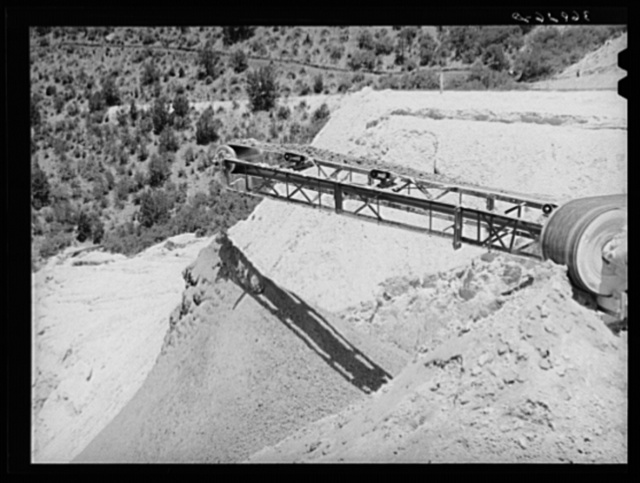 Belt conveyor which drops the tailings onto pile in the valley below. Mill at Mogollon, New Mexico