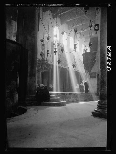 Bethlehem. Int[erior]. Nativity Church at Xmas [i.e., Christmas] time. Sun's rays