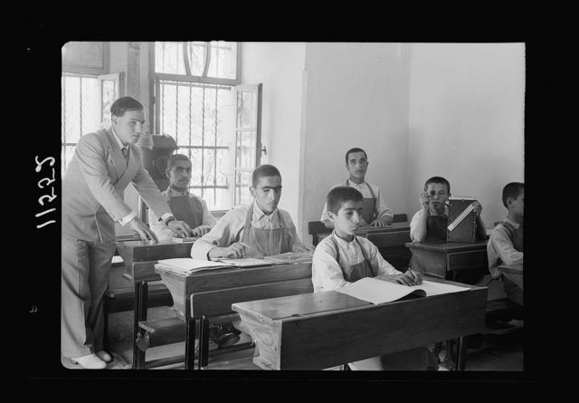 Blind school in Hebron. Class of older boys reading braille