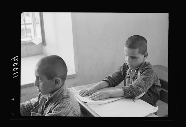 Blind school in Hebron. Close up of small boy reading braille
