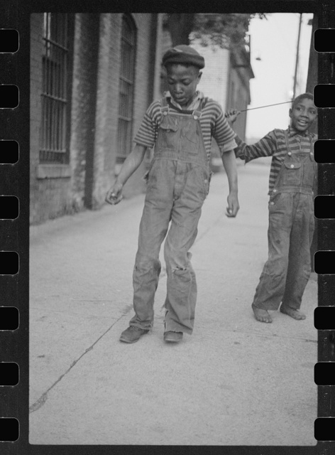 Boy dancing for arrivals at hotel, price five cents, Cairo, Illinois