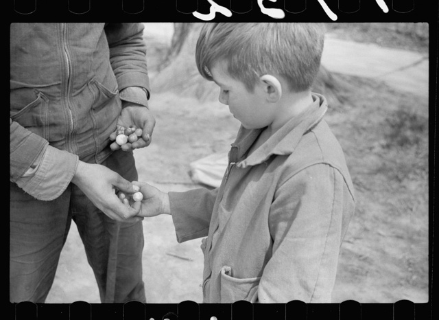 Boys in marble game, Woodbine, Iowa